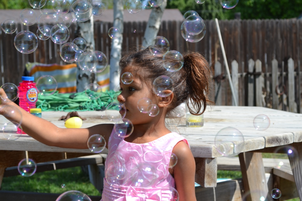 Photo of little girl with bubbles